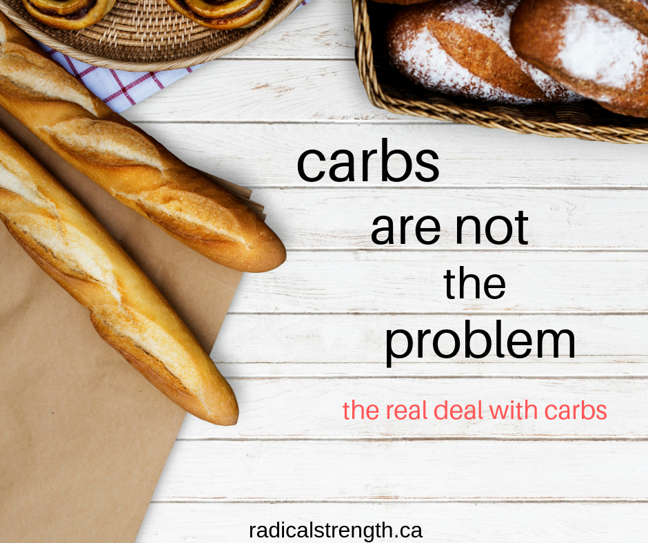 carbs are not the problem bread on a wooden background