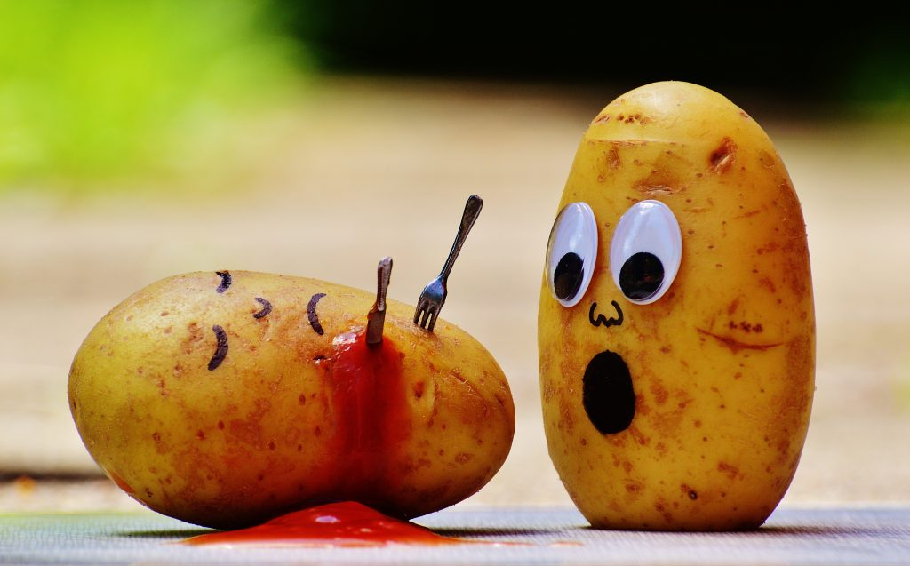Potato stabbed with fork