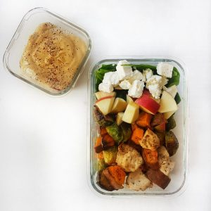 meal prep salad with brussel sprouts, sweet potatoes, apple, feta, chicken