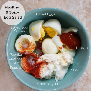 Simple Meal Prep lunch egg salad. Spicy egg salad meal prep made with cayenne pepper and sriracha sauce. Eggs and sriracha are a match made in heaven! #mealprep #eggsalad #spicy #healthymealprep
