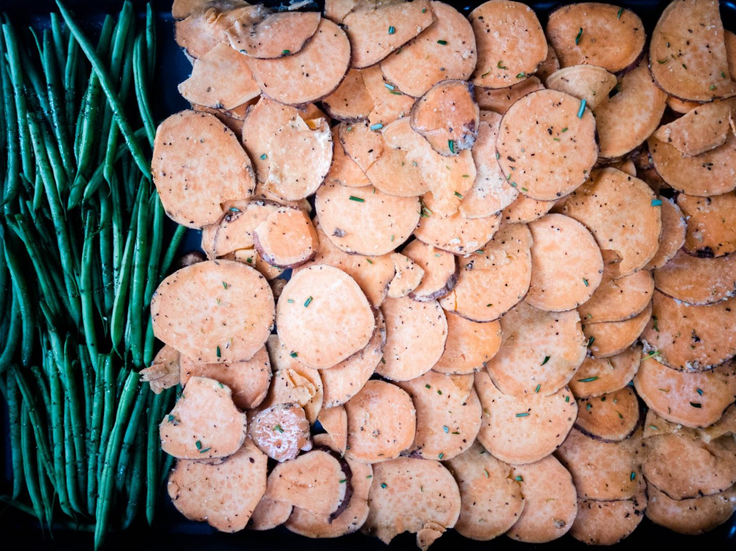 sweet potato coins and green beans on sheet pan