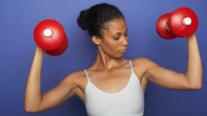 woman holding dumbbells for workout