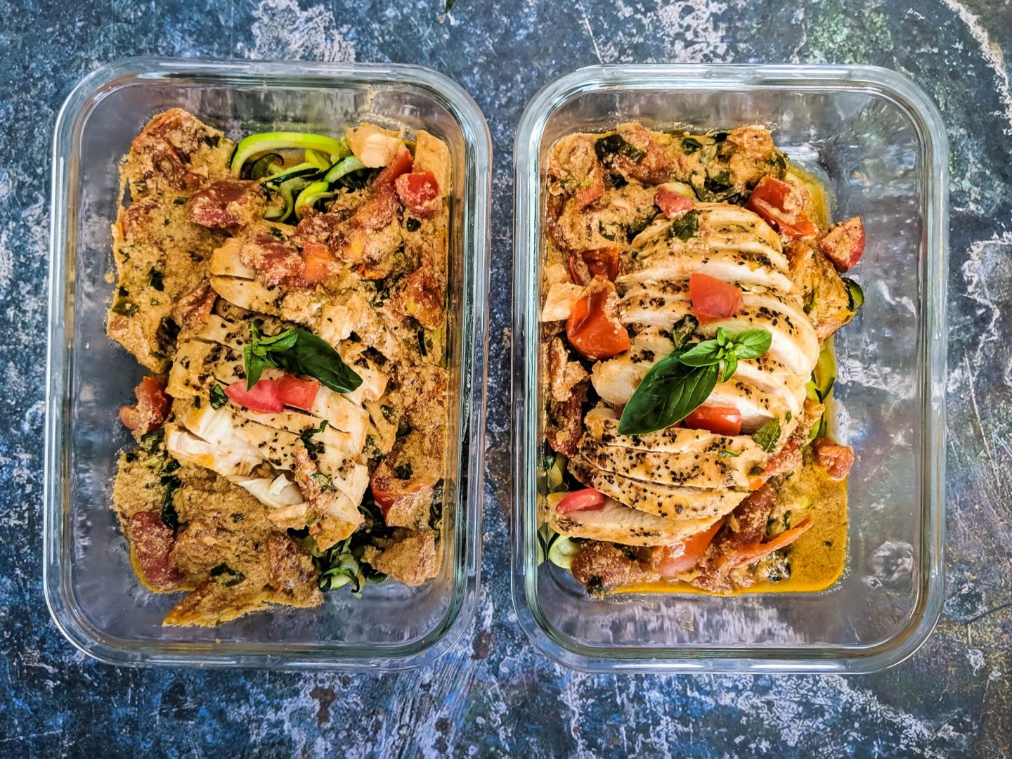 creamy tomato basil chicken in meal prep containers with zucchini noodles