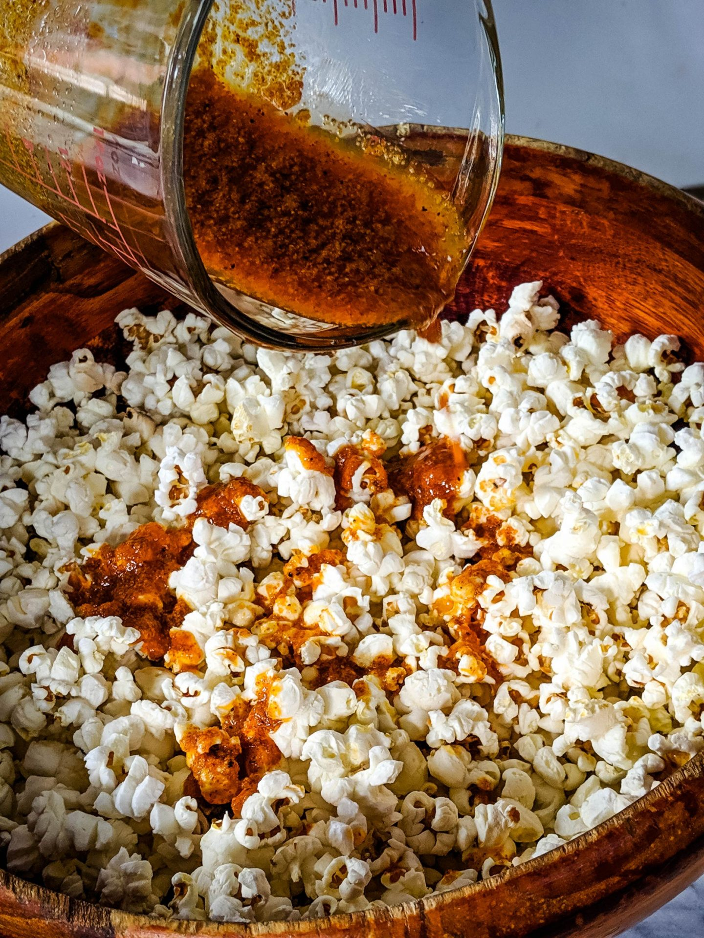 popcorn recipe seasoning poured on popcorn