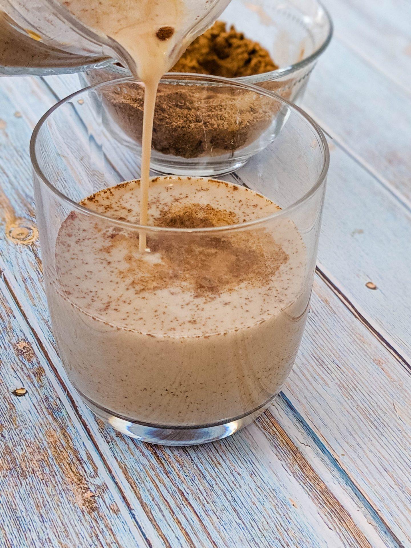 pour latte into cup