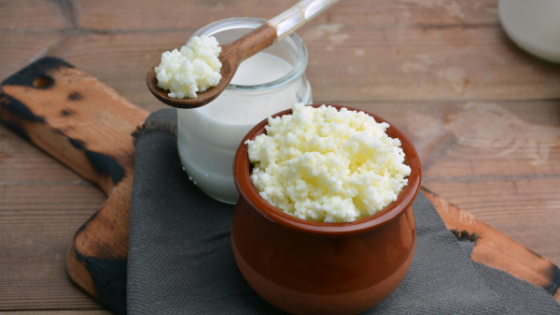 kefir grains and milk with spoon