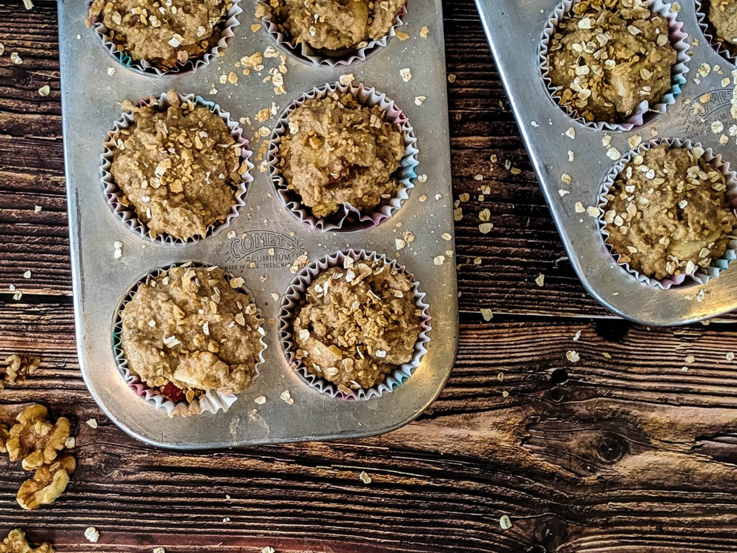 cinnamon apple healthy muffins batter in tins